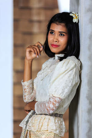 Beautiful Woman with Thai Traditional Dress King Rama 5 posing in old building Reklamní fotografie