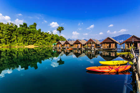 Floating Bungalows with kayaks at Khao Sok National Park, Cheow Lan Lake, Surat Thani, Thailand