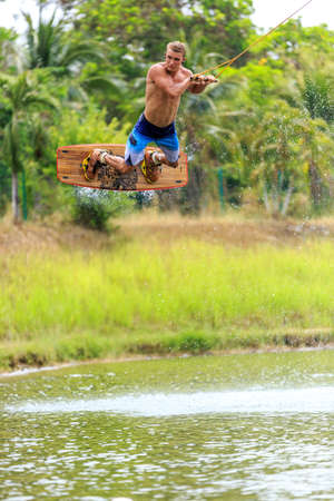 Man Wakeboarding. Jumping. Phuket, Thailand