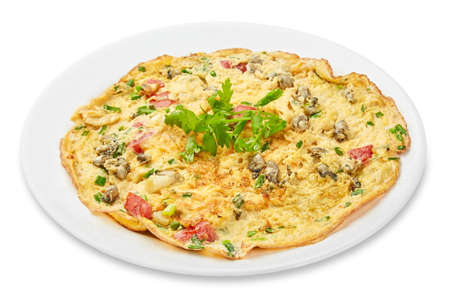 Omelet with mushrooms and tomatos isolated on the white background with clipping path