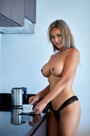 Asian topless sensua lady cooking coffee at the kitchen