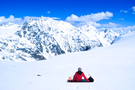 achievment: Woman in mountains, standing and watching beautiful mountain landscape in Elbrus, Russia