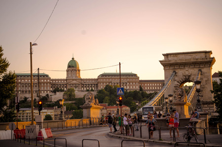 szechenyi: BUDAPEST - July 2015- The Szechenyi Chain Bridge in Budapest, cars and people in the evening in summer, Budapest, Hungary