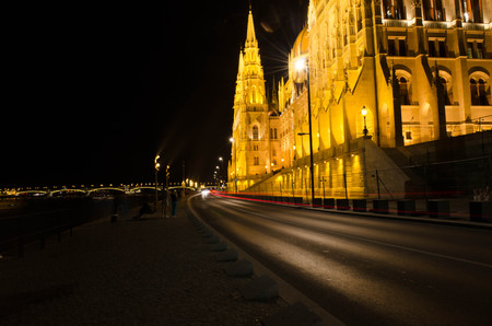 obuda: Budapest Cityscape at night with the Hungarian Parliament Beautiful reflection in the water of Danube river.