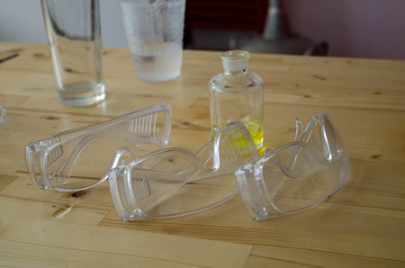 protective eyewear: Protective Eyewear  Safety Glasses and glassware in chemical lab. Stock Photo
