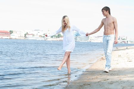 blondy: blondy girl on the beach with man Stock Photo