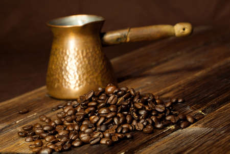 caffee: Coffee beans on old wooden table Stock Photo