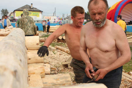 sawhorse: TOMSK, RUSSIA - AUGUST 9: Annual international festival-competition of carpenters - Holiday of Axe, August 9, 2009 in Tomsk, Russia.