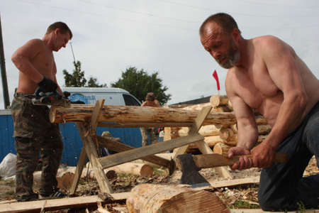 TOMSK, RUSSIA - AUGUST 9: Annual international festival-competition of carpenters - Holiday of Axe, August 9, 2009 in Tomsk, Russia.