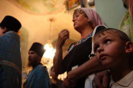 pious: TOMSK, RUSSIA - AUGUST 9: Orthodox celebrations devoted to the second finding of a wonder-working icon of Our Lady from village of Bogorodsky, August 9, 2009 in Tomsk, Russia.