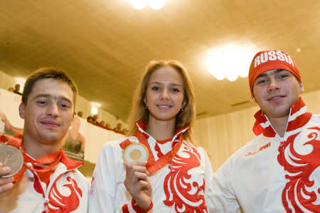 TOMSK, RUSSIA - AUGUST 28: Olympic Champions 2008 - Gymnasts - Anton Golotsutskov, Margarita Aliychuk and Konstantin Pluzhnikov in the regional government of Tomsk, August 28, 2008 in Tomsk, Russia.