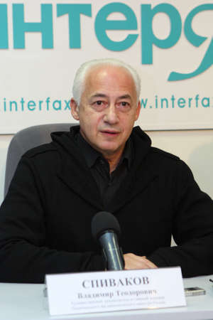 orchestrate: TOMSK, RUSSIA - December 4: Vladimir Spivakov - artistic director and chief conductor of the National Philharmonic Orchestra of Russia in agency Interfax-Siberia, December 4, 2009 in Tomsk, Russia.