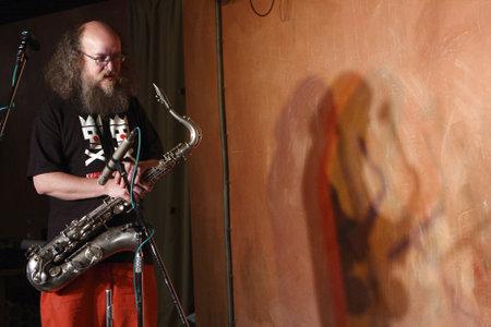 NOVOSIBIRSK, RUSSIA - SEPTEMBER 5: Sergey Letov - legendary jazz musician and improviser, playing the saxophone performance in nightclub The Stray Dog, September 5, 2008 in Novosibirsk, Russia.