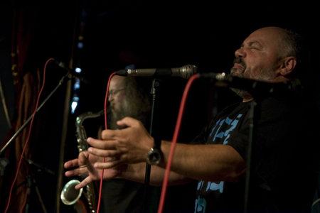 arkady: NOVOSIBIRSK, RUSSIA - SEPTEMBER 5: Sergey Letov - legendary jazz musician and jazz vocalist Arkady FreeMan Kirichenko performance in nightclub The Stray Dog, September 5, 2008 in Novosibirsk, Russia.
