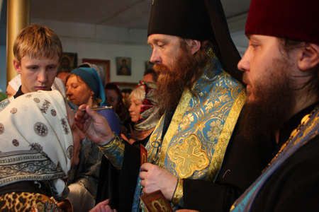 pious: TOMSK, RUSSIA - AUGUST 9: Rostislav - Archbishop of Tomsk and Asino, commits the ceremony ritual in the orthodox church, August 9, 2009 in Tomsk, Russia.
