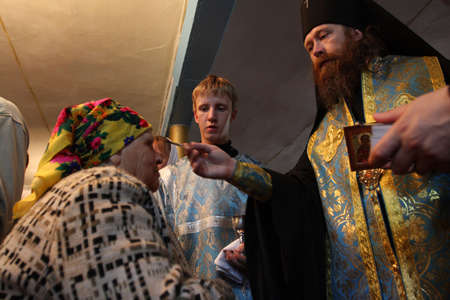 commits: TOMSK, RUSSIA - AUGUST 9: Rostislav - Archbishop of Tomsk and Asino, commits the ceremony ritual in the orthodox church, August 9, 2009 in Tomsk, Russia.