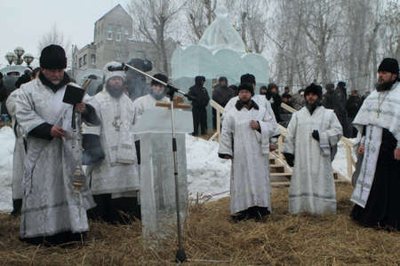 commits: TOMSK, RUSSIA - JANUARY 19: Consecration ice-hole, Rostislav - Archbishop of Tomsk and Asino, commits the ceremony ritual, celebration of Epiphany (Holy Baptism), January 19, 2010 in Tomsk, Russia.