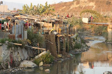 slum: KATHMANDU, NEPAL - JANUARY 7: A generic view of a poor housing area at Old Baneshwor near Bagmati river January 7, 2009 in Kathmandu Nepal.