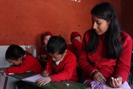 kathmandu: KATHMANDU, NEPAL - JANUARY 1: Conducting lesson in small primary school (Happy Home School) in poor area of city, January 1, 2009 in Kathmandu, Nepal.