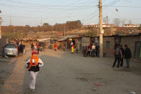 indigence: KATHMANDU, NEPAL - JANUARY 7: A generic view of a poor housing area at Old Baneshwor near Bagmati river January 7, 2009 in Kathmandu Nepal.