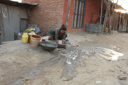 penury: KATHMANDU, NEPAL - JANUARY 7: A generic view of a poor housing area at Old Baneshwor near Bagmati river January 7, 2009 in Kathmandu Nepal.