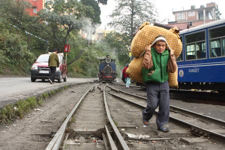 DARJEELING, INDIA - DECEMBER 3: The Darjeeling Himalayan Railway, nicknamed the Toy Train, is a 2 ft (610 mm) narrow-gauge railway from Siliguri to Darjeeling, December 3, 2008 in Darjeeling, India. Stock Photo - 6889021