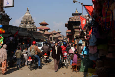 closed community: KATHMANDU, NEPAL - JANUARY 6: View of the Durbar Square, Patan January 6, 2009 in Kathmandu, Nepal. It is one of the three royal cities in the Kathmandu, a very popular spot for tourists.