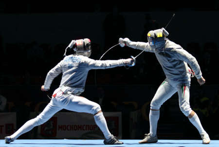 sabel: MOSCOW, RUSSIA - FEBRUARY 13: Rares Dumitrescu (ROU) and Zsolt Nemcsik (HUN) compete at the 2010 RFF Moscow Saber World Fencing Tournament, February 13, 2010 in Moscow, Russia.