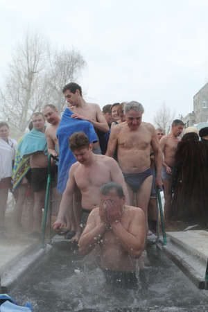 TOMSK, RUSSIA - JANUARY 19: Swimming in the ice-hole, celebration of Epiphany (Holy Baptism) in the Orthodox tradition, January 19, 2010 in Tomsk, Russia. Stock Photo - 6897031