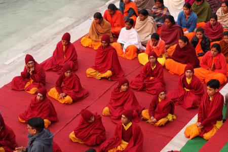 ashram: RISHIKESH, INDIA - JANUARY 19: Hindu students from the Parmath Niketan Ashram hold ceremonial lanterns during the daily aarti prayer on the River Ganges, January 19, 2009 in Rishikesh, India. Editorial
