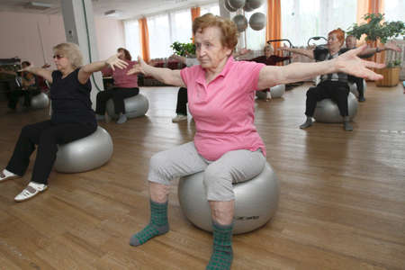 ball stretching: PODPOROZHYE, RUSSIA - JUNE 4: Day of Health in Center of social services for pensioners and the disabled Otrada (gymnastics with ball for elders), June 4, 2010 in Podporozhye, Russia.