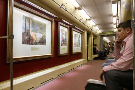 aquarelle painting art: Aquarelle - subway train with a new collection of masterpieces by watercolor artists from the Russian Museum set out from Partizanskaya station, May 12, 2010 in Moscow, Russia.
