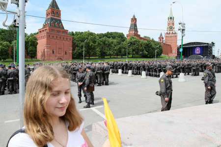 militia: MOSCOW - MAY 24: Militia and guard near the Kremlin, while celebrating the Holiday of St. Cyril and Methodius, the creators of Cyrillic alphabet, May 24, 2010 in Moscow, Russia.