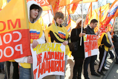 demonstrator: Action of the protest of public organization Young socialists of Russia against high tariffs of housing and communal services, March 25, 2010 in Moscow, Russia. Editorial