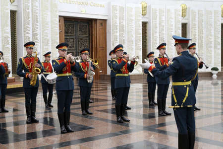 Delegation: MOSCOW - APRIL 21: Military orchestra on ceremony of transfer of the symbolic Victory Banner of the delegation of the Republic of Kazakhstan in the Hall of Fame, April 21, 2010 in Moscow, Russia.