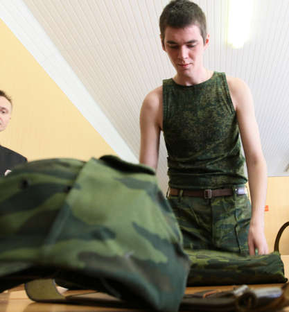 conscripts: MOSCOW - JUNE 18: Army conscripts receiving military uniform, a collection point, June 18, 2010 in Moscow, Russia. Editorial