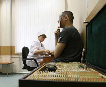 conscripts: MOSCOW - JUNE 18: Conscripts from the Moscow region undergoing a medical examination at the recruitment center, June 18, 2010 in Moscow, Russia. Editorial