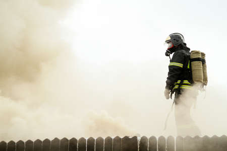 demolished house: MOSCOW - APRIL 30: Firefighters extinguishing fire at the Viking floating restaurant on the Berezhkovskaya embankment, April 30, 2010 in Moscow, Russia.  Editorial