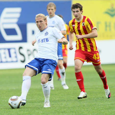 MOSCOW - MAY 15: Dinamos Andrei Voronin (L) and Alanias Jury Kirillov (R) in a game - Dinamo Moscow vs. Alania Vladikavkaz - 2:0, May 15, 2010 in Moscow, Russia.