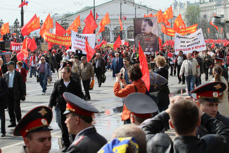 dictator: MOSCOW - MAY 1: Communist party supporters take part in a rally marking the May Day, a portrait of Soviet dictator Josef Stalin seen in the background, May 1, 2010 in Moscow, Russia. Editorial