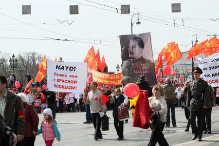 MOSCOW - MAY 1: Communist party supporters take part in a rally marking the May Day, a portrait of Soviet dictator Josef Stalin seen in the background, May 1, 2010 in Moscow, Russia. Stock Photo - 7289021