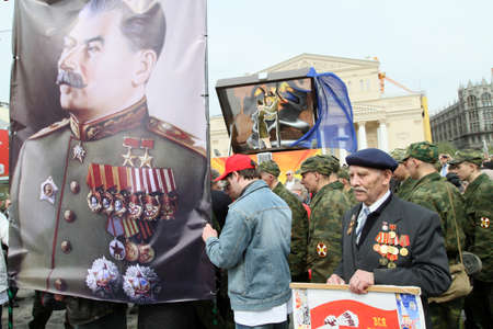 dictator: MOSCOW - MAY 1: Communist party supporters take part in a rally marking the May Day, a portrait of Soviet dictator Josef Stalin, May 1, 2010 in Moscow, Russia.