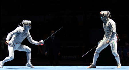 sabel: MOSCOW, RUSSIA - FEBRUARY 13: Duel for Cup Grand Prix event, Eun S.Oh (KOR) and Zsolt Nemcsik (HUN) compete at the 2010 RFF Moscow Saber World Fencing Tournament, February 13, 2010 in Moscow, Russia.