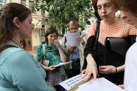perturbed: MOSCOW - JUNE 10: People perturbed by the actions of the police in breaking up rallies, filed a complaint in the police department