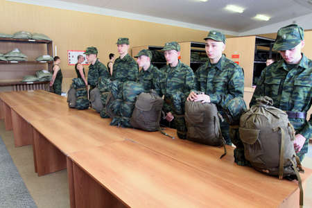 conscripts: MOSCOW - JUNE 18: Army conscripts receive military uniform, a collection point, June 18, 2010 in Moscow, Russia.