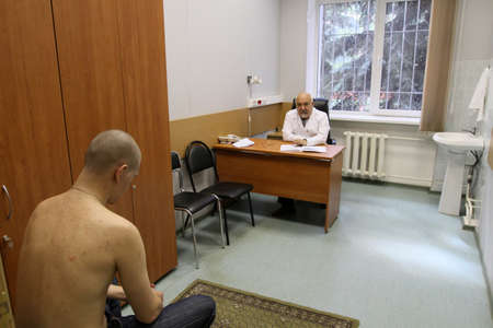 conscripts: MOSCOW - JUNE 18: Conscripts from the Moscow region undergoes a medical examination at the recruitment center, June 18, 2010 in Moscow, Russia.