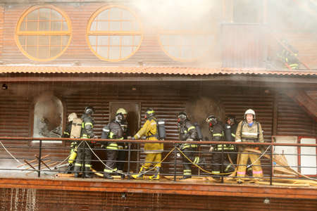 MOSCOW - APRIL 30: Firefighters extinguishing fire at the Viking floating restaurant on the Berezhkovskaya embankment, April 30, 2010 in Moscow, Russia. Stock Photo - 7289132