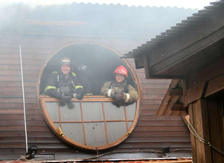 extinguishing: MOSCOW - APRIL 30: Firefighters extinguishing fire at the Viking floating restaurant on the Berezhkovskaya embankment, April 30, 2010 in Moscow, Russia. Editorial