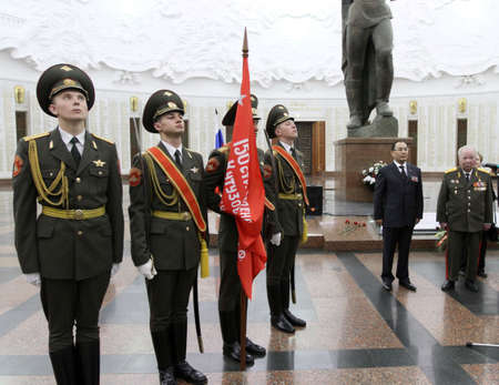 Delegation: MOSCOW - APRIL 21: Ceremony of transfer of the symbolic Victory Banner of the delegation of the Republic of Kazakhstan in the Hall of Fame Museum of the Patriotic War, April 21, 2010 in Moscow, Russia