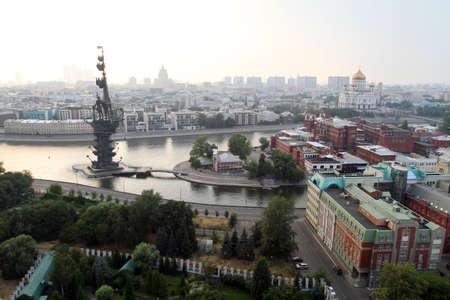 merging: General view from the top of the merging of the Moscow River and the Bypass canal in Moscow, monument to Peter I (left), The Cathedral of Christ the Savior (right)